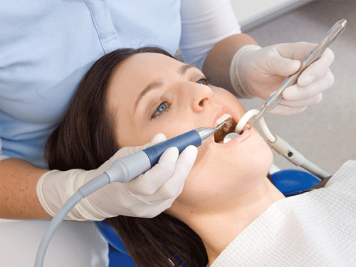 professional-teeth-cleaning-with-scaler.png